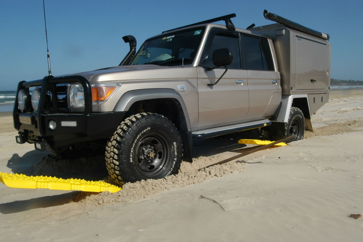 4WD on sand ladders to get through the sand on the beach