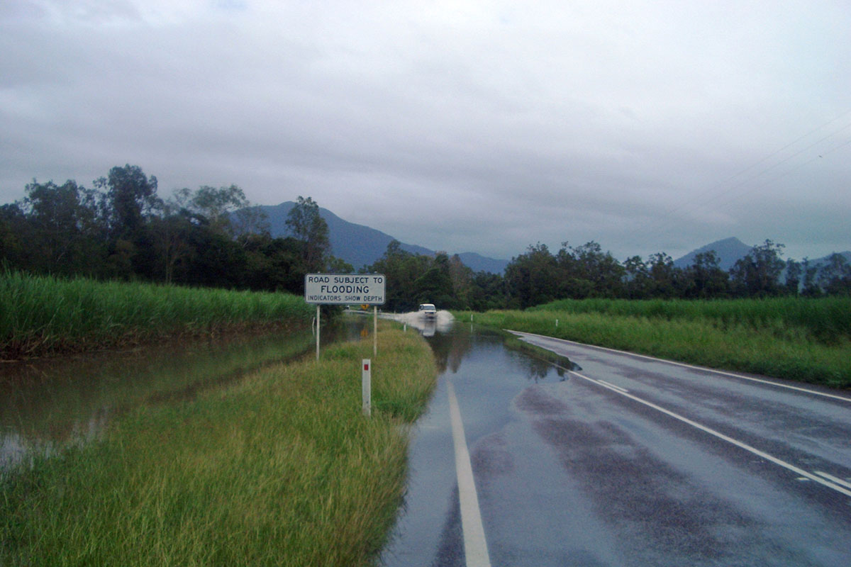 Road subject to flooding, on a wet day