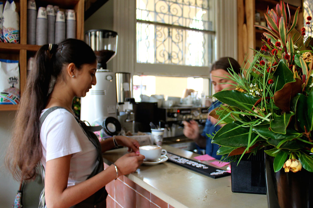 barista's making coffees in a cafe