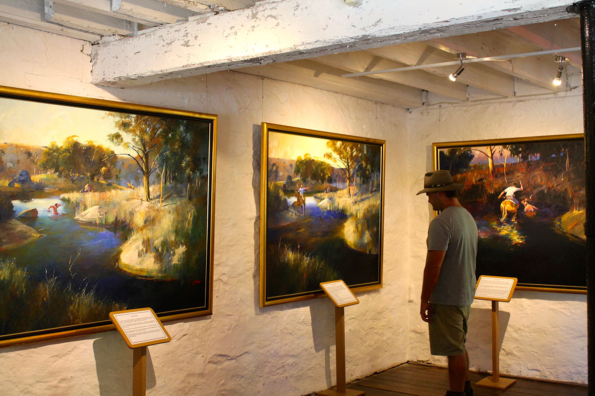 Man looking at art in a country town museum in Tamworth