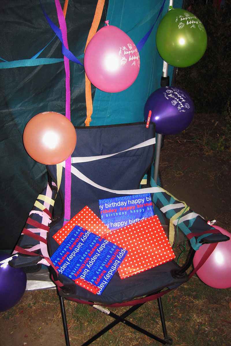 birthday celebrations on a camping chair