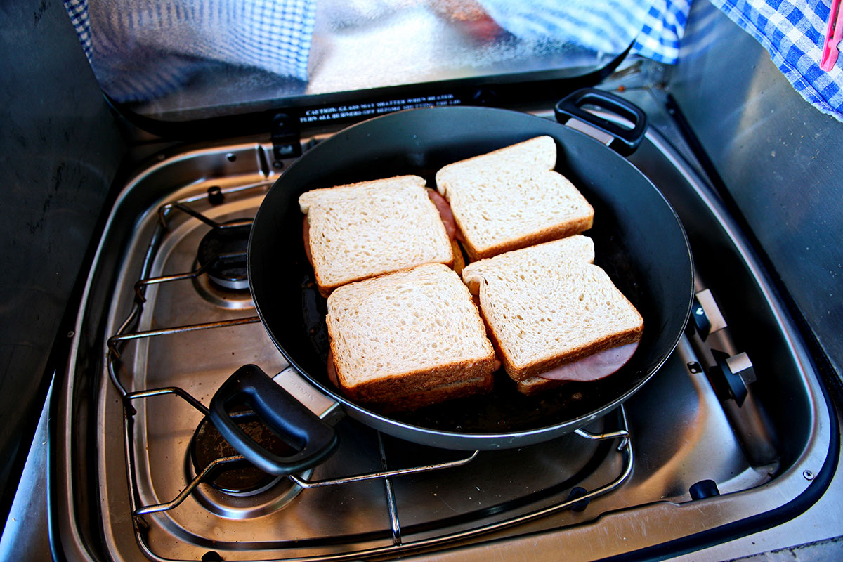 sandwiches on a pan being grilled