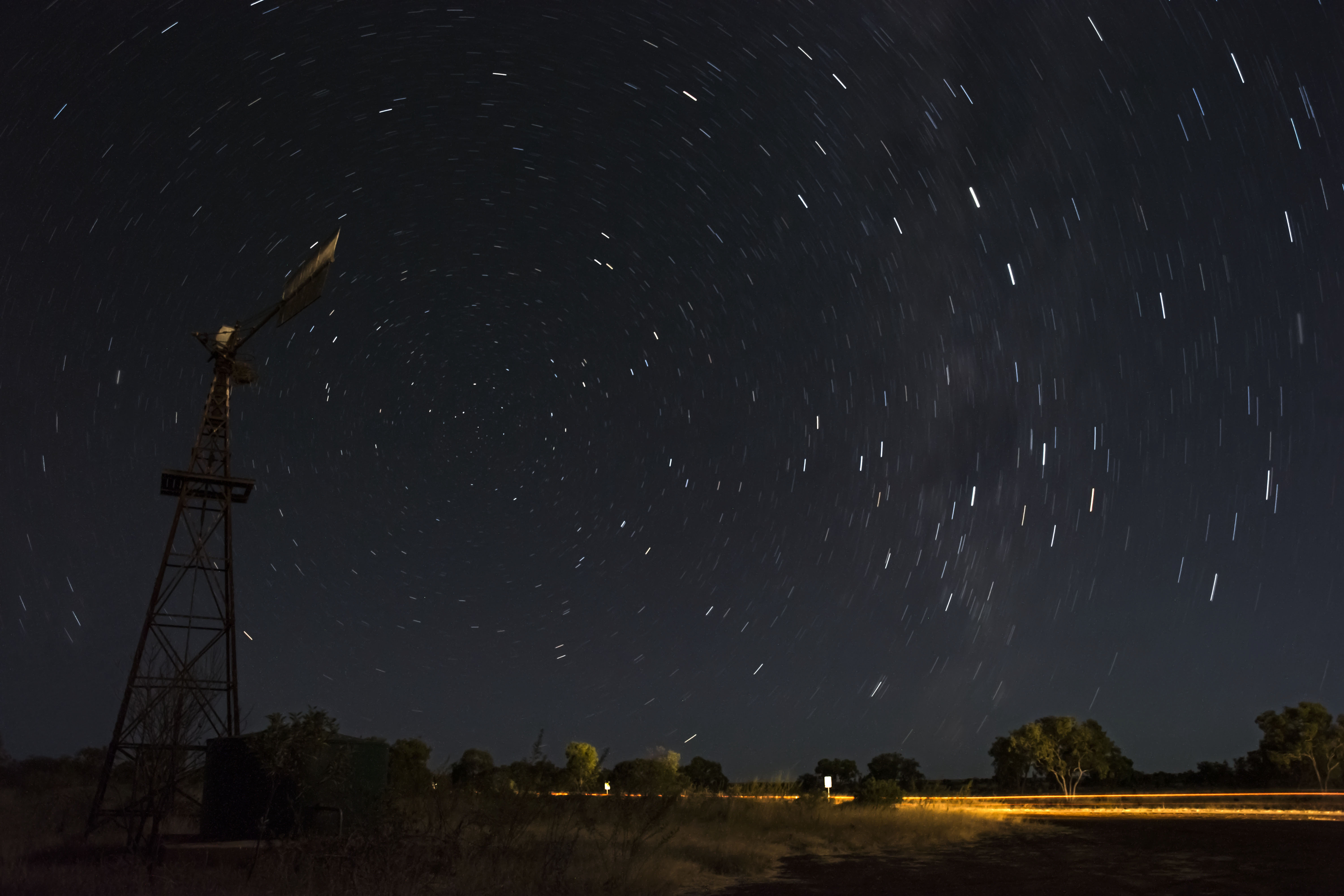Night sky with a windmill