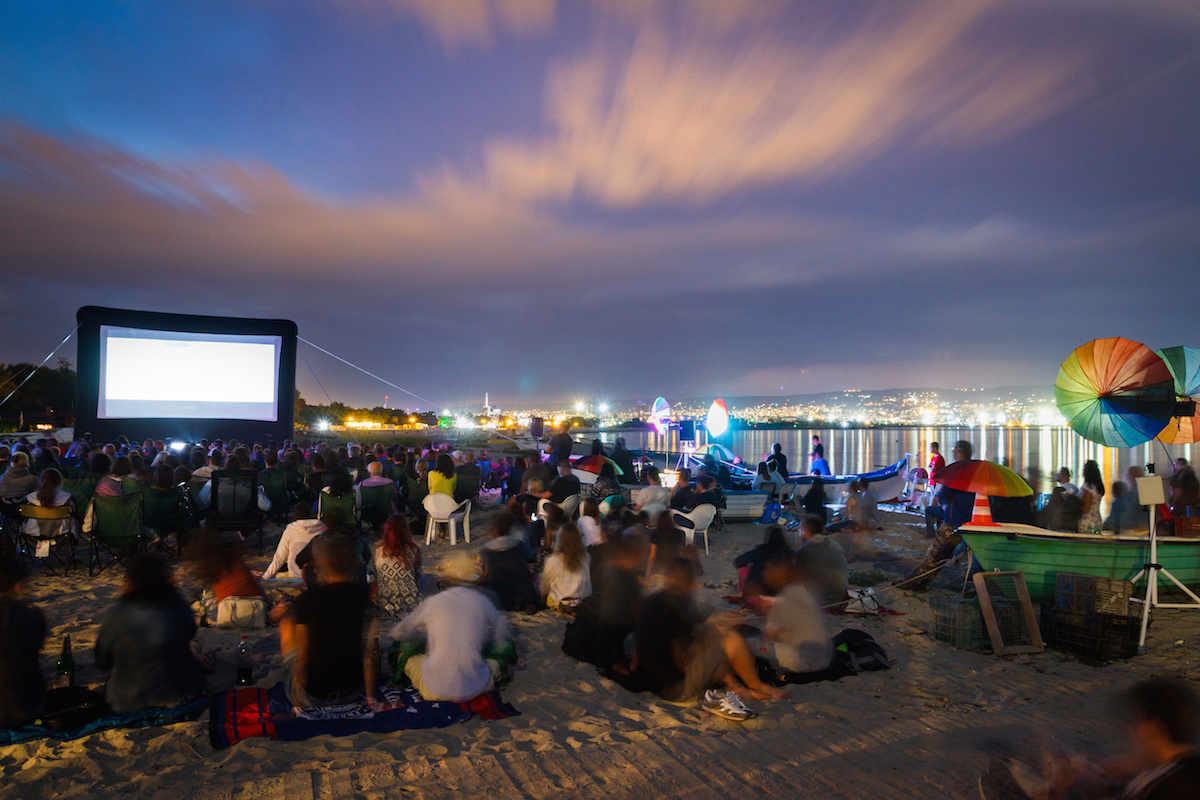 MOVIE CINEMA ON THE BEACH WITH CITY BEHIND
