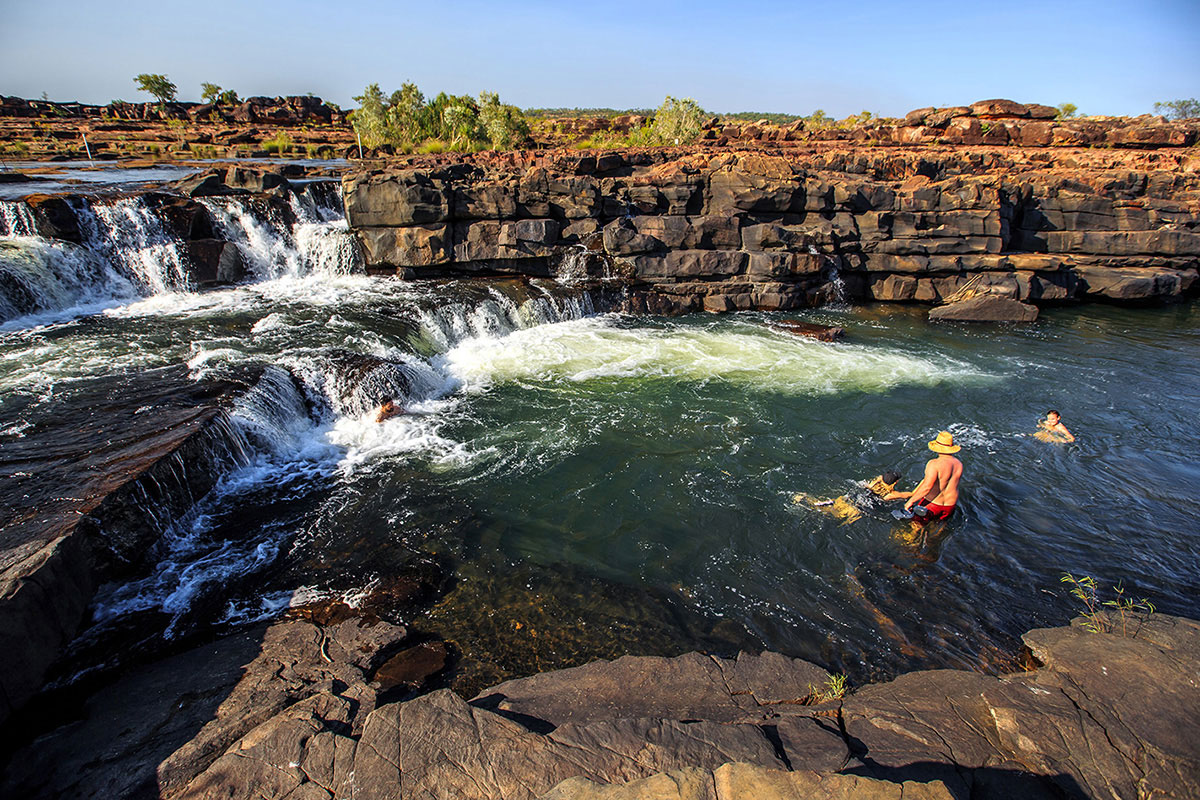 People-swimming-at-the-waterfall-at-the-Gibb-River-Road
