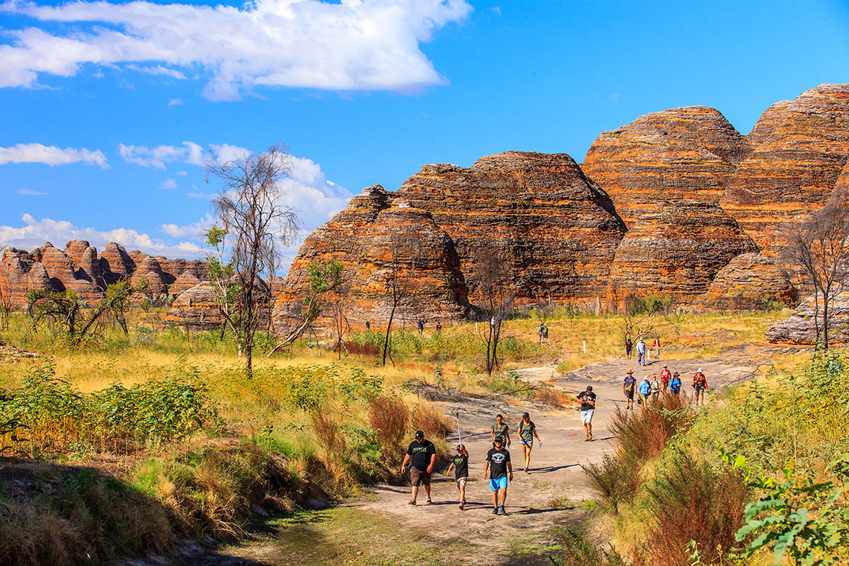 People-walking-next-to-rock-formations-at-the-Gibb-River-Road