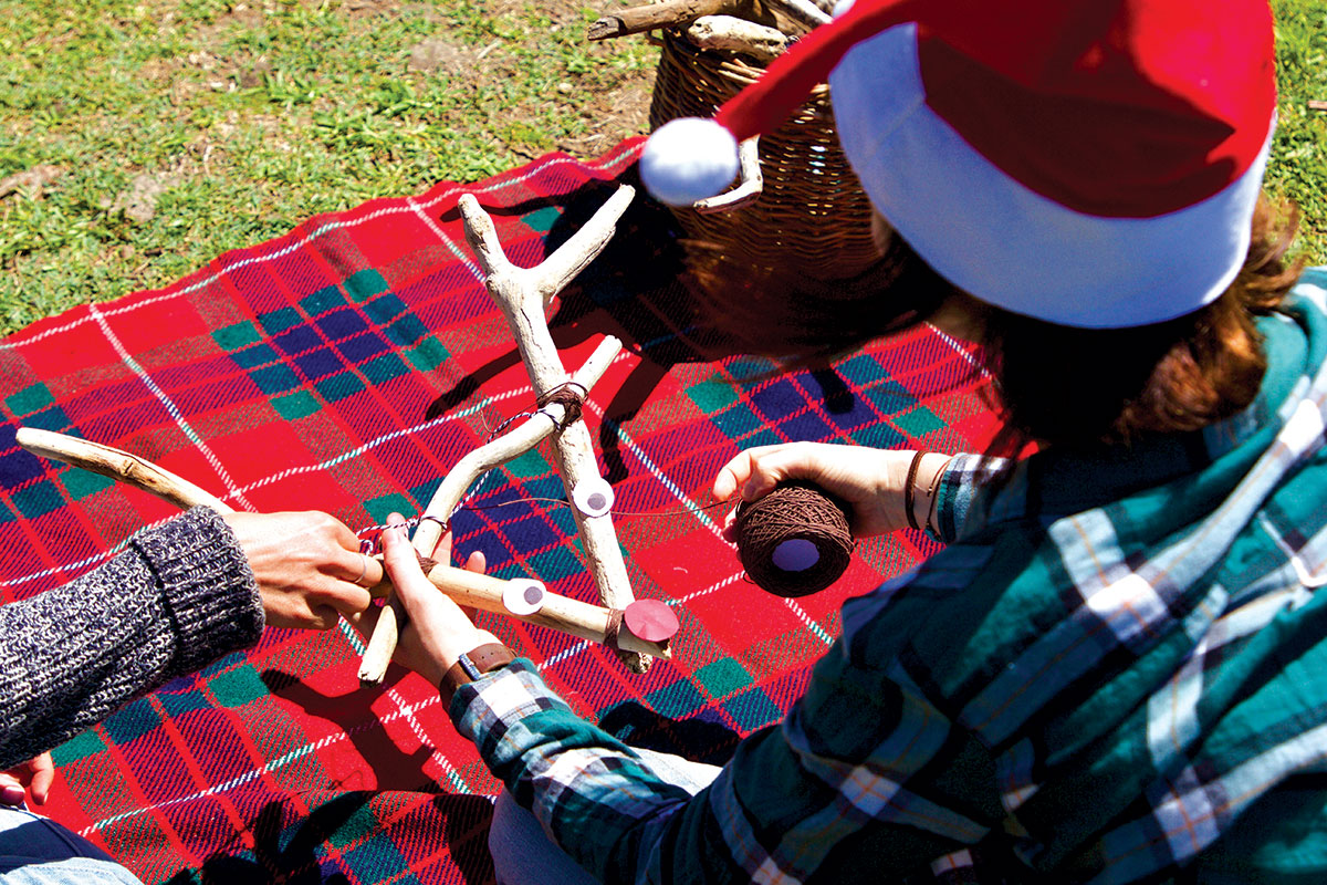 People-making-Rudolph-at-a-campsite