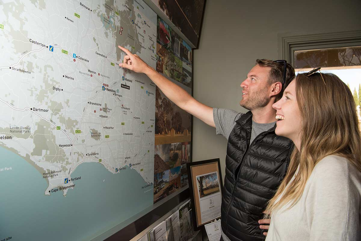 Couple-looking-at-a-map-in-Dunkeld-VIC